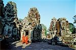 Cambodia, Angkor Thom, monks walking between face towers of the Bayon Stock Photo - Premium Rights-Managed, Artist: Asia Images, Code: 849-02866057