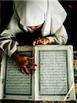 Malaysia, Selangor, Malay girl reading the Koran written in Jawi, the Malay language written in Arabic script. Stock Photo - Premium Rights-Managed, Artist: Asia Images, Code: 849-02866744