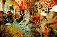 Indonesia, a Muslim cleric reading from the Koran to bind bride and groom in marriage. Stock Photo - Premium Rights-Managednull, Code: 849-02866783