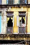 Myanmar (Burma), Yangon (Rangoon), A man looking out of a window in an old colonial building. Stock Photo - Premium Rights-Managed, Artist: Asia Images, Code: 849-02866932