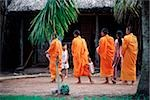 Vietnam, Mekong Delta region, Bac Lieu, Buddhist monks walking on street in search of alms. Stock Photo - Premium Rights-Managed, Artist: Asia Images, Code: 849-02867166
