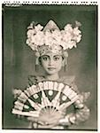 Indonesia, Bali, Amlapura, Legong dancer in full costume holding fan. Stock Photo - Premium Rights-Managed, Artist: Asia Images, Code: 849-02867601