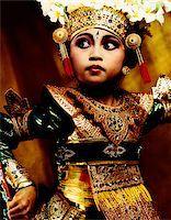 Indonesia, Bali, Amlapura, Legong dancer in dance position. Stock Photo - Premium Rights-Managednull, Code: 849-02867611