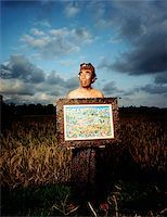 Indonesia, Bali, Ubud, Balinese artist holding painting in rice field. Stock Photo - Premium Rights-Managednull, Code: 849-02867615