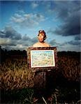 Indonesia, Bali, Ubud, Balinese artist holding painting in rice field. Stock Photo - Premium Rights-Managed, Artist: Asia Images, Code: 849-02867615