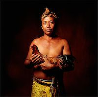 Indonesia, Bali, Ubud, Balinese man holding fighting cock. Stock Photo - Premium Rights-Managednull, Code: 849-02867624