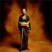 Indonesia, Bali, Ubud, Mature Balinese woman in ceremonial dress. Stock Photo - Premium Rights-Managednull, Code: 849-02867629