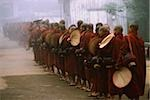 Myanmar (Burma), Bago, Buddhist monks with fans line up to collect alms. Stock Photo - Premium Rights-Managed, Artist: Asia Images, Code: 849-02867898