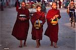 Myanmar (Burma), Sangaing, Buddhist monks returning to monastery after collecting alms. Stock Photo - Premium Rights-Managed, Artist: Asia Images, Code: 849-02867947