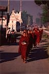 Myanmar (Burma), Nyaungshwe, Inle lake, Buddhist monks returning to monastery after collecting alms. Stock Photo - Premium Rights-Managed, Artist: Asia Images, Code: 849-02867953