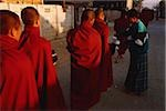 Myanmar (Burma), Inle lake, Buddhist monks receiving alms. Stock Photo - Premium Rights-Managed, Artist: Asia Images, Code: 849-02868001