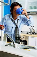 Man in kitchen, drinking from bowl Stock Photo - Premium Rights-Managednull, Code: 849-02871464
