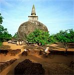 Sri Lanka, Polonnaruwa ancient city, rankot vehera, tourist cycling past on bicycle Stock Photo - Premium Rights-Managed, Artist: Asia Images, Code: 849-02872101