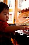 Toddler playing the piano