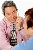 Doctor having consultation with patient, using stethoscope Stock Photo - Premium Rights-Managednull, Code: 849-02875394