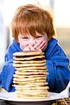 Happy Little Boy With a Stack of Pancakes