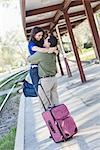 Happy Couple Hugging at Train Station Stock Photo - Premium Rights-Managed, Artist: Kevin Dodge, Code: 700-02883119