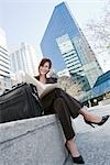 Businesswoman Sitting Outdoors Talking on Cell Phone Stock Photo - Premium Rights-Managed, Artist: Kevin Dodge, Code: 700-02883123