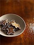 Mini Gingerbread Men in a Bowl and Sugar Sprinkled on Table Stock Photo - Premium Rights-Managed, Artist: Yvonne Duivenvoorden, Code: 700-02883257