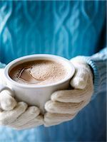 Woman Wearing a Sweater and Mittens Holding a Mug of Frothy Hot Chocolate Stock Photo - Premium Rights-Managednull, Code: 700-02883261