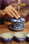 Hand placing lid on tea cup Stock Photo - Premium Royalty-Free, Artist: dk & dennie cody, Code: 633-02885691