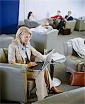 Businesswoman Using Laptop in Lounge Stock Photo - Premium Rights-Managed, Artist: Bob Devan, Code: 700-02887119