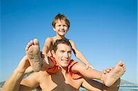Young boy on father's shoulders in Cape Town, Western Cape Province, South Africa Stock Photo - Premium Royalty-Freenull, Code: 682-02891289