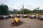Bonfire in the middle of table and chairs set up for meal, Kapama Lodge, Limpopo Province, South Africa Stock Photo - Premium Royalty-Free, Artist: Scanpix Creative         , Code: 682-02891443