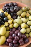 pimento - A Collection of Stuffed Green Olives;Green Olives;Black Olives and Calamata Olives in a Ceramic Bowl Stock Photo - Premium Royalty-Freenull, Code: 682-02893242