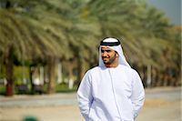 Smiling Arab Man Standing in Park Near Date Trees Stock Photo - Premium Royalty-Freenull, Code: 682-02894223