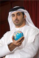 Arab business man holding globe Stock Photo - Premium Royalty-Freenull, Code: 682-02894279
