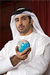 Arab business man holding globe Stock Photo - Premium Royalty-Free, Artist: Beyond Fotomedia, Code: 682-02894279