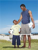 Father and son with soccer ball Stock Photo - Premium Royalty-Freenull, Code: 682-02894690