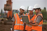 Workers on laptop at construction site. Johannesburg, Gauteng Province, South Africa Stock Photo - Premium Royalty-Freenull, Code: 682-02894914