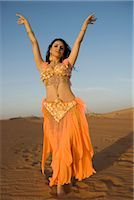 Young Belly Dancer Dancing in the Desert Stock Photo - Premium Royalty-Freenull, Code: 682-02895165