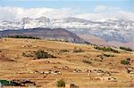 Small rural village in front of the snow covered Drakensberg Mountains. Winterton, KwaZulu-Natal Province, South Africa