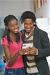 South African teen culture - Young couple looking at DVD cover. Stock Photo - Premium Royalty-Free, Artist: Tom Collicott, Code: 682-02896151