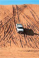 Low angle view of 4x4 vehicle descending dune. Dubai, United Arab Emirates. Stock Photo - Premium Royalty-Freenull, Code: 682-02896308
