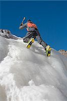 spike - Hiker Ice Climbing up a Frozen Waterfall Stock Photo - Premium Royalty-Freenull, Code: 682-02896451