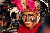 pictures philippine festivals philippines - Portrait of a man with facial decoration and head-dress with feathers at Mardi Gras carnival, Dinagyang in Iloilo City on Panay Island, Philippines, Southeast Asia, Asia Stock Photo - Premium Rights-Managednull, Code: 841-02899066