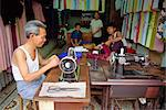 Tailor working at a sewing machine, and his family, in their shop in the old quarter of Hanoi, Vietnam, Indochina, Southeast Asia, Asia Stock Photo - Premium Rights-Managed, Artist: Robert Harding Images, Code: 841-02899956