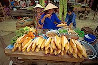 food stalls - Woman street vendor selling French bread sandwiches from her stall on the pavement in Nhatrang, Vietnam, Indochina, Southeast Asia, Asia Stock Photo - Premium Rights-Managednull, Code: 841-02899997