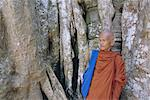 Buddhist monk in Ta Prohm temple, Angkor, UNESCO World Heritage Site, Siem Reap, Cambodia, Indochina, Asia