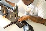 Man Sewing Leather Goods, Maida's Black Jack Boot Company, Houston, Texas, USA Stock Photo - Premium Rights-Managed, Artist: Mark Peter Drolet, Code: 700-02912107