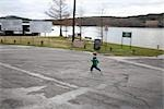 Boy Running Across Parking Lot, Austin, Texas, USA