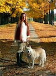 Portrait of Woman with Dog in Park in Autumn Stock Photo - Premium Rights-Managed, Artist: Natasha Nicholson, Code: 700-02912387