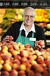 Grocery Clerk Arranging Peaches in Produce Aisle Stock Photo - Premium Royalty-Free, Artist: Brian Pieters, Code: 600-02912448