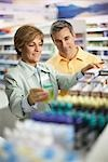 Pharmacist Helping Customer Stock Photo - Premium Rights-Managed, Artist: Brian Pieters, Code: 700-02912451