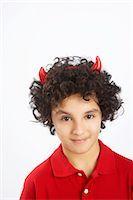 Little Boy Dressed as Devil Stock Photo - Premium Royalty-Freenull, Code: 600-02912785