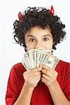 Little Boy Dressed as Devil Holding Cash Stock Photo - Premium Royalty-Free, Artist: Edward Pond, Code: 600-02912786